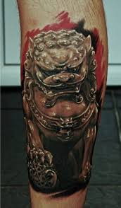 angry egypt style dog tattoo on leg tattoomagz