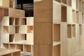 penda develops pixelated wooden interior for tech store