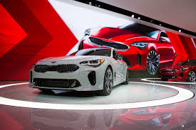 cheap sports cars 2017 the kia stinger is a sports sedan that sizzles in a sea of