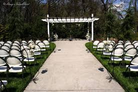 a brisk sunny day in the gardens at the gray gables wedding venue