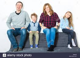 the livingroom nice family sit on the livingroom sofa stock photo royalty free