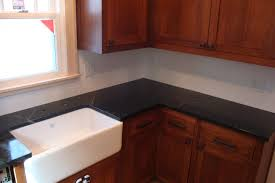 granite countertop kohler kitchen sink racks faucet with built