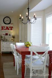 best 10 red dining rooms ideas on pinterest long walls kitchen in our dining room i like everything about this the red table the dresser with the floating shelves the giant red eat sign the white chairs