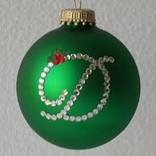 christmas glass ornaments decorated with vinyl cut with my