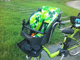 a green electric bike with a cool