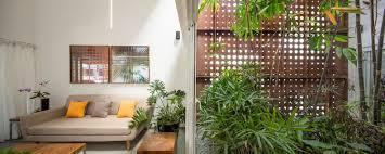 a gorgeous home split by a covered garden atrium