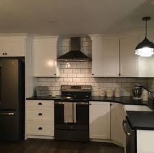 antique white kitchen cabinets with subway tile backsplash white cabinets with black counters and white subway tile