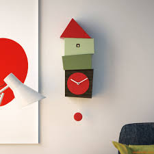 crooked wall cuckoo clock made of wood with pendulum different