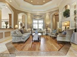 traditional living room with built in bookshelf u0026 hardwood floors