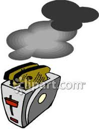 Burning Toaster Toast In A Toaster Royalty Free Clipart Picture