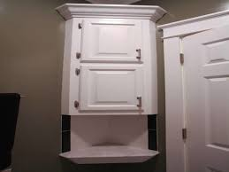 bathrooms cabinets enclosed toilet paper holder free standing