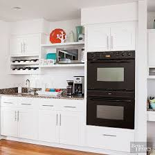 what to put on top of kitchen cabinets for decoration ideas for decorating above kitchen cabinets better homes
