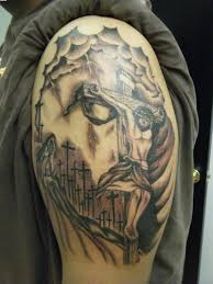 cross with jesus tattoo design photos pictures and sketches