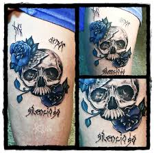 beautiful skull decorated with blue roses skull tattoos