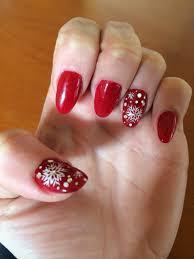 red nail design red nail polish oval nails snow flake design