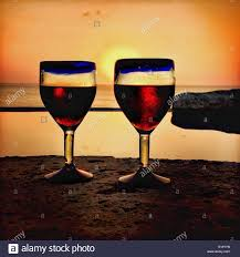 two mexican hand blown blue rimmed glasses filled with red wine