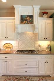 white cabinets with travertine backsplash crystal drawer knobs