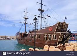 crete rethymnon harbour pirate ship stock photo royalty free