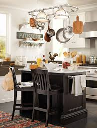 clear up room in your cabinets by hanging pots and pans