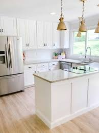 painting kitchen cabinets from wood to white painting kitchen cabinets white kitchen reveal