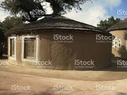 mud hut or adobe house with decorated wall stock photo 180295420