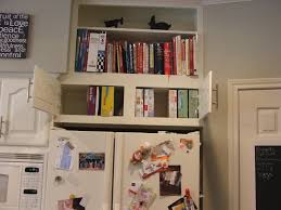 top of fridge storage use shelf above fridge to store cookbooks and might be nice to