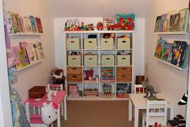 attractive colorful kids room shelf applied on the wooden floor it