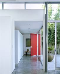 beach entry modern with red front door wooden accent and storage