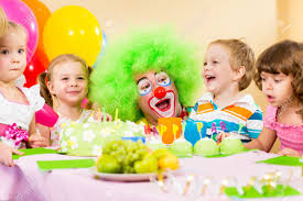 clowns for a birthday party kids celebrating birthday party with clown stock photo picture