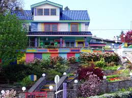 exterior house in rgb colors fits with green plants on front yard