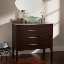 dark brown solid wood vanity cabinet with tempered glass sink