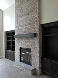 new construction indoor fireplace stone fireplace built ins