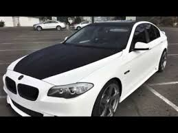 bmw white car bmw 535i white carbon fiber vinyl wrap black carbon accents