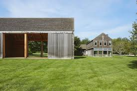 bridgehampton barn style house with tunnel to party barn curbed
