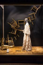 best 25 store window displays ideas on pinterest display window the dining room chairs are flying trough the room pinned by ton van der veer