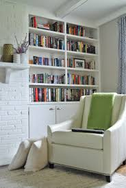 simple home library design for small space with wall bookshelves f