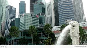 singapore lion singapore 063 water spouting lion and skyscrapers stock