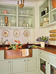 country kitchen decorated with flower vase and wall plates and