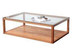 glass top coffee table made with salvaged wood slabs in raw edge