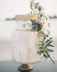 picture of marble wedding cake with gold leaf strokes flowers and