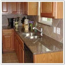 tropic brown granite with black silgranit sink kitchen ideas