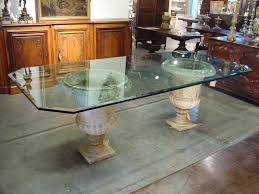 beveled glass table top on antique french stone urns from
