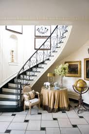 winding curved stair case elegant deocr marble floor foyer