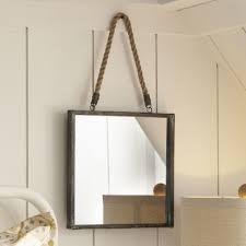 goodhue mirror with its metal frame and hanger this