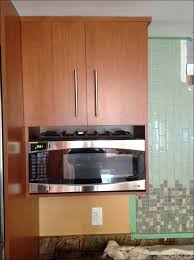 kitchen the kitchen includes oak cabinets quartz countertops two full size of kitchen the kitchen includes oak cabinets quartz countertops two ovens a 42