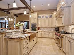traditional kitchen with limestone tile floors u0026 flat panel