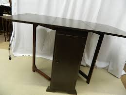 Oak Drop Leaf Dining Table 1930s Oak Drop Leaf Dining Table With Storage Cupboards