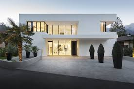 front view modern white house design by monovolume architecture