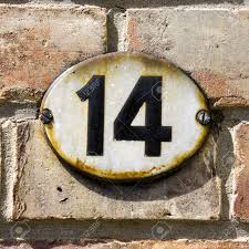 enameled house number fourteen black lettering on an oval plate
