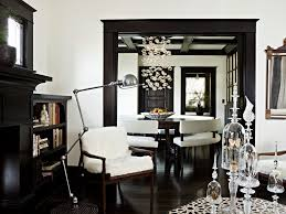 white walls dark trim living room traditional with round dining